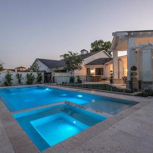 Imagen de piscinas y jacuzzis alargados, clásicos renovados, grandes, rectangulares, en patio trasero, con suelo de baldosas