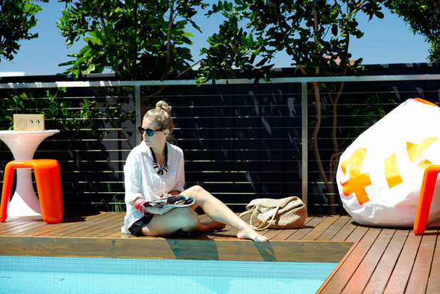 Contemporary Swimming Pool by Secret Gardens