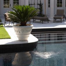 Traditional Pool by plantation building corp