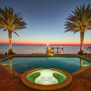 Inspiration for a mediterranean custom-shaped pool remodel in Tampa
