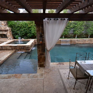 Design ideas for a small transitional backyard custom-shaped pool in Dallas with a water feature and stamped concrete.