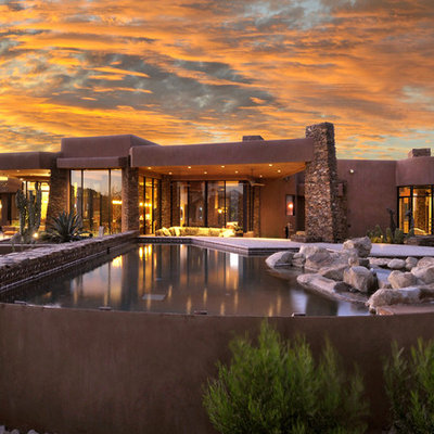Mid-sized southwest backyard custom-shaped and concrete paver natural pool photo in Phoenix
