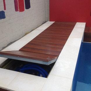 Esempio di una piscina monocorsia minimal di medie dimensioni e dietro casa