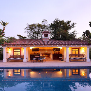 Photo of a mediterranean swimming pool in Los Angeles with a pool house.