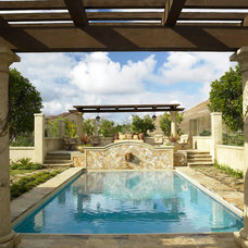 Mediterranean Pool by Pacific Cornerstone Architects, Inc