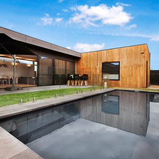 Large contemporary backyard rectangular pool in Melbourne.