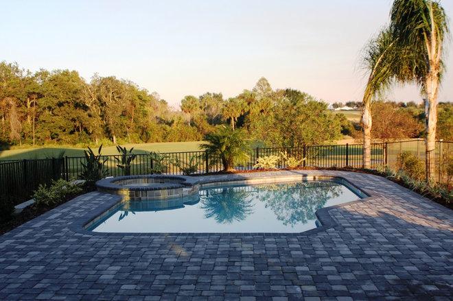 Contemporary Pool by MJS Inc. Custom Home Designs