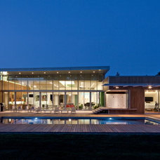 Contemporary Pool by McKay Landscape Lighting