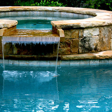 Stacked Stone Spa with Waterfall Spillover