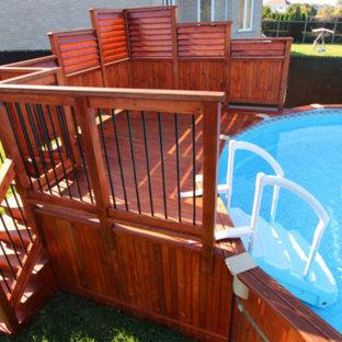 Imagen de piscina elevada, de estilo americano, de tamaño medio, redondeada, en patio trasero