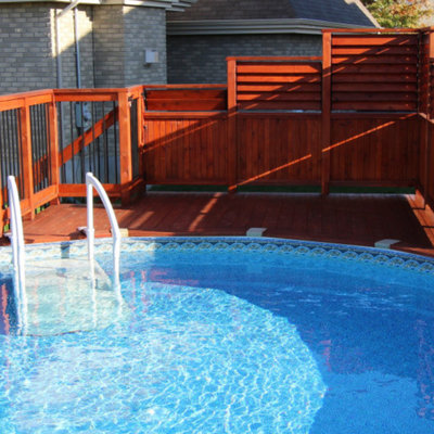 Example of a mid-sized arts and crafts backyard round aboveground pool design in Montreal
