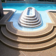 Traditional Pool by Pebble Stone Coatings