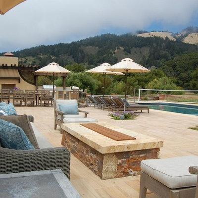 Inspiration for a large mediterranean backyard tile and rectangular hot tub remodel in San Francisco