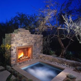 Photo of a country rectangular pool in San Diego with a hot tub.