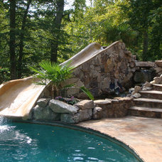 Rustic Pool by Custom Pools and Landscapes of Richmond