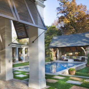 Pool house - traditional courtyard concrete paver and rectangular pool house idea in Austin