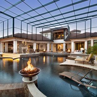 Modelo de piscina con fuente infinita, mediterránea, grande, interior y a medida, con losas de hormigón