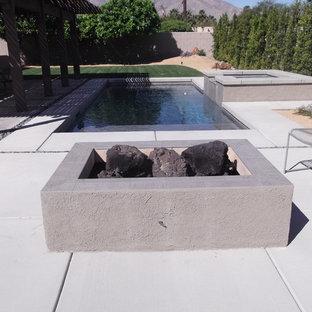 Diseño de piscina vintage, pequeña, rectangular, con losas de hormigón