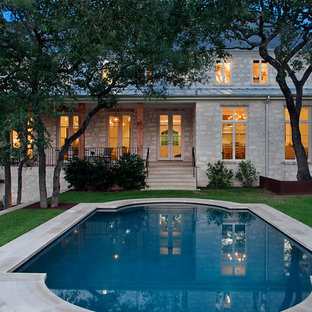 Inspiration for a mid-sized timeless backyard custom-shaped and concrete paver pool remodel in Austin