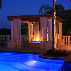 Mediterranean Pool by MJS Inc. Custom Home Designs