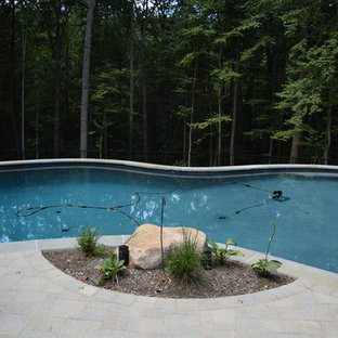 Inspiration for a rustic pool remodel in Baltimore