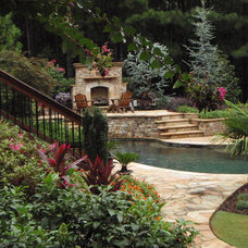 Traditional Pool Suburban Backyard Retreat by Lawns by Hand, Inc.
