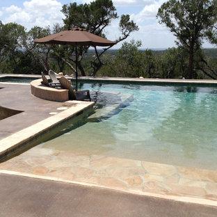 Large minimalist backyard custom-shaped lap hot tub photo in Austin with decking