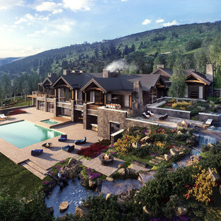 Photo of an expansive modern backyard rectangular infinity pool in Denver with a hot tub and concrete pavers.