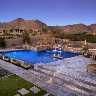 Inspiration for a mid-sized southwestern backyard stone and custom-shaped infinity pool fountain remodel in Phoenix