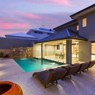 Photo of a small contemporary backyard l-shaped pool in Perth.
