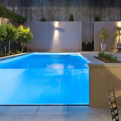 Mid-sized minimalist backyard stone and rectangular aboveground pool photo in Melbourne