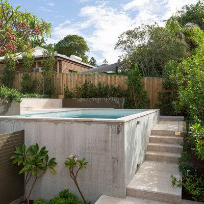 Mid-sized minimalist backyard stone and rectangular aboveground pool photo in Perth