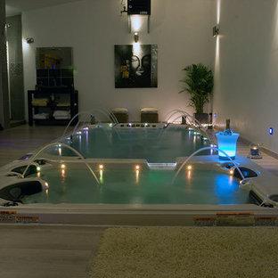 Foto de piscinas y jacuzzis de estilo zen, de tamaño medio, rectangulares, en patio trasero, con entablado