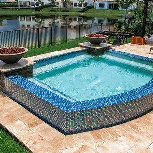 Swim Spa With Custom Fire Bowls and Outdoor Kitchen in Cooper City, Florida