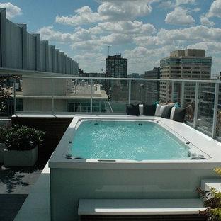 Diseño de piscinas y jacuzzis modernos, de tamaño medio, rectangulares, en azotea