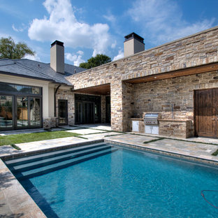 This is an example of a mediterranean rectangular pool in Houston with natural stone pavers.