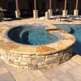 Design ideas for an expansive tropical backyard pool in Atlanta.