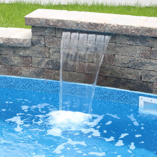 Design ideas for a small transitional backyard custom-shaped pool in New York with a water feature and concrete pavers.