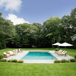 Inspiration for a large timeless backyard stone and rectangular pool remodel in New York