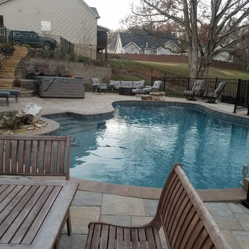 Swimming pool project with retaining walls and patio