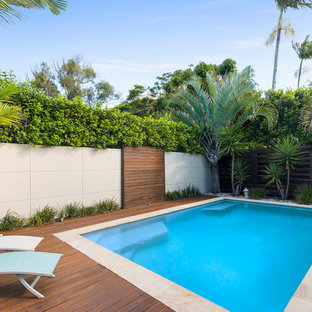 Inspiration for a beach style backyard rectangular pool in Gold Coast - Tweed with decking.