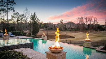 SWIMMING POOL WITH FIRE BOWLS