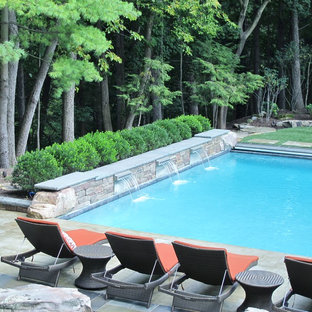 SWIMMING POOL WITH WATERFALL, BAR, POOL HOUSE, & FIRE PIT
