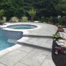 Traditional Pool by FS Landscaping Contractors Inc