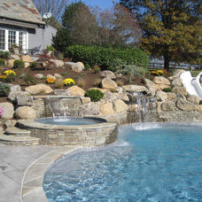 Contemporary Pool by FS Landscaping Contractors Inc