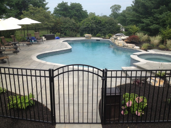 Traditional Pool by FS Landscaping Contractors, Inc.