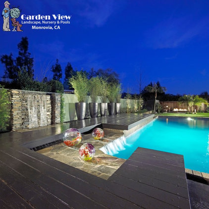 Contemporary Pool by Garden View
