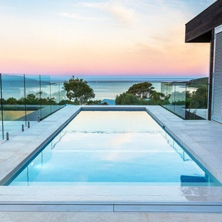 Inspiration for a mid-sized contemporary side yard rectangular pool in Perth with tile.