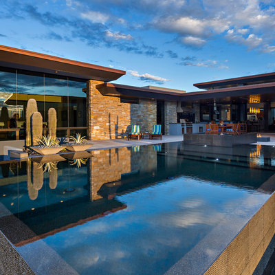 Example of a southwest backyard custom-shaped aboveground pool fountain design in Other