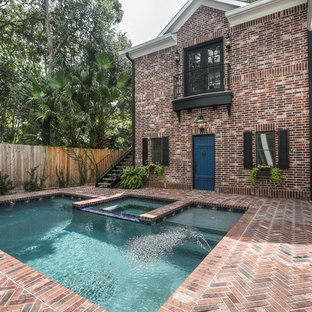 Example of a large classic backyard brick and rectangular lap hot tub design in Houston